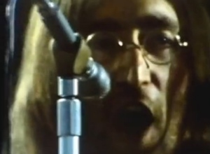 "John belting out ""Don't Let Me Down"" in a clip from ""Let it Be"""