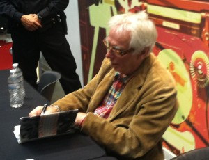 Glyn Johns autographs a book at Saturdays Rock Hall event.